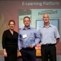David Wheeler, Training Manager, collects the award
